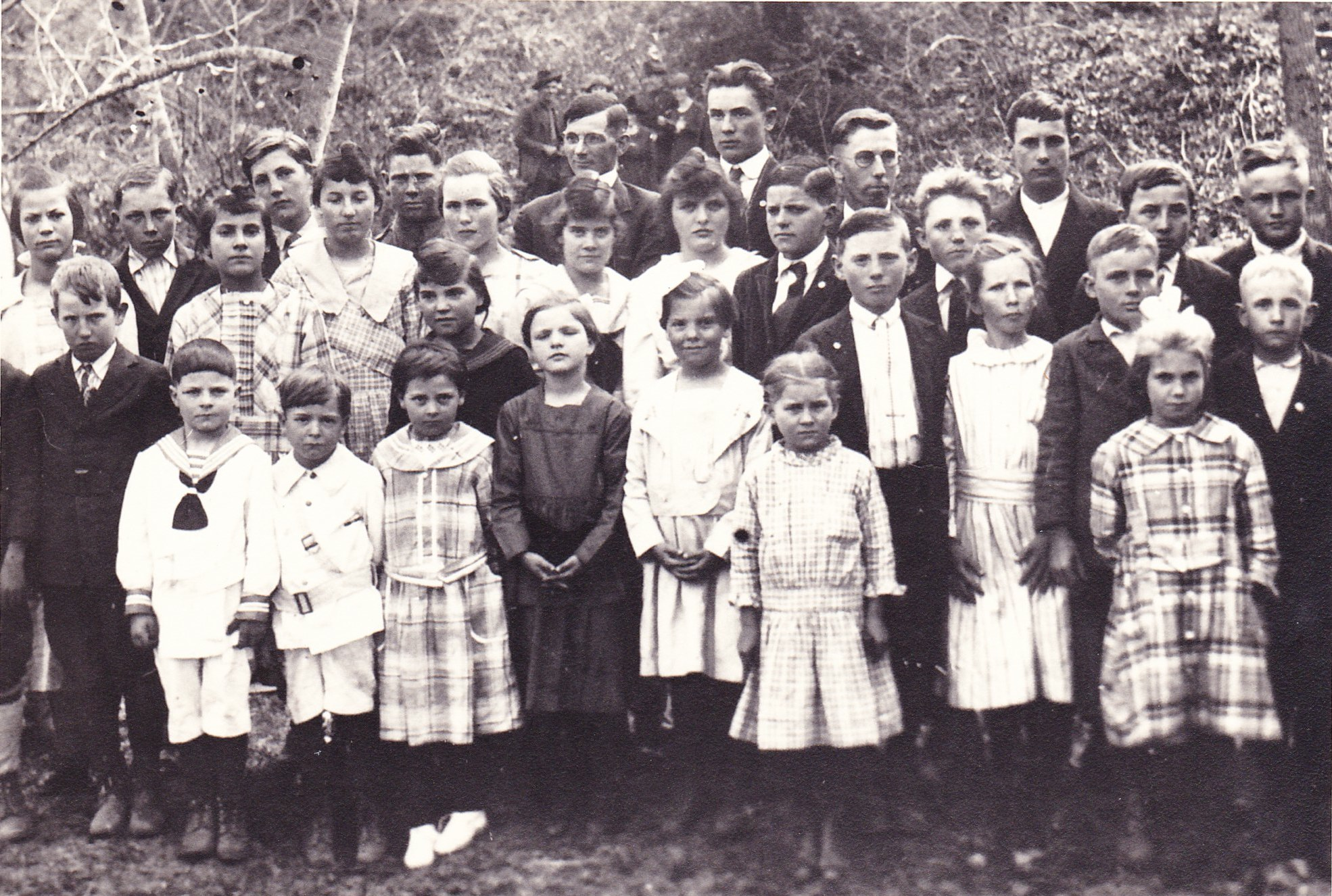 Smith and Eckards at Stony Run School: 1st Row: Paul Vernon (Vernon) Eckard, 1st boy on left in white; Hazel Jane Eckard, 4th on 1st row in dark dress. 2nd Row: Beulah Eckard is in middle with white beside Claude Cameron (Cameron) Eckard in dark coat and white shirt with tie. 3rd Row: Maybe Lula Smith with light hair and light complexion.
